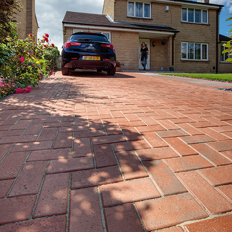 Image of new driveway using Marshall's classic paving in red